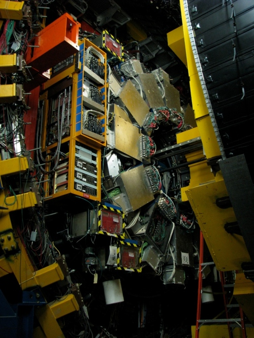 The inside of the Collider Detector at Fermilab (CDF). Protons and antiprotons enter the detector from opposite directions, via the thin gray pipe barely visible at the image center. During collisions, these particles dissolve into their constituent quarks and (since this is quantum physics) many other things. [Credit: moi]