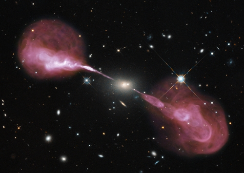 The radio galaxy Hercules A, seen in visible light (the galaxy at the center, background galaxies) and radio light, which shows the huge jets of matter streaming from the galaxy's central black hole. [Credit;  NASA, ESA, S. Baum & C. O'Dea (RIT), R. Perley and W. Cotton (NRAO/AUI/NSF),and the Hubble Heritage Team (STScI/AURA)]
