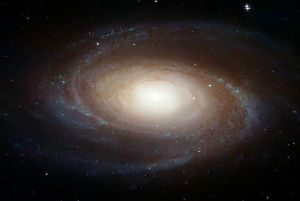 The spiral galaxy M81, as seen by the Hubble Space Telescope. Galaxies such as this contain roughly 10 times as much dark matter as ordinary matter. [Credit: NASA/ESA/Hubble Heritage Team (STScI/AURA)]
