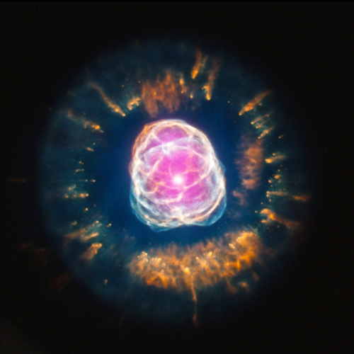 The death of a star much like our Sun is a thing of beauty. This is the nebula NGC 2392, as imaged in visible light and X-rays (the pink colors). [Credit: X-ray: NASA/CXC/IAA-CSIC/N.Ruiz et al, Optical: NASA/STScI]