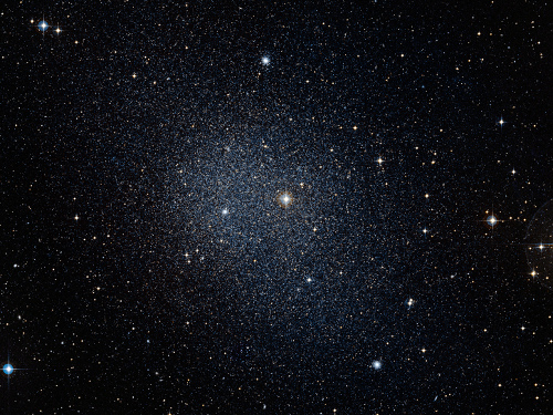 The Fornax dwarf spheroidal galaxy, a satellite of the Milky Way. The brightness of this galaxy is sufficiently low that it's very hard to see, much less study. [Credit: ESO/Digital Sky Survey 2]