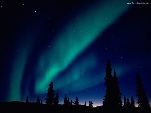 The Aurora borealis — the Northern Lights — over Alaska. The green color is emission from oxygen atoms high in the atmosphere, when charged particles from the Sun strike them. [Credit: Well_Lucio on Flickr]