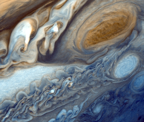 Jupiter's clouds as seen by Voyager 1. While we often focus on the huge storms — the Great Red Spot at upper right — instead look at the turbulent whorls of clouds surrounding it. [Credit: NASA/Caltech/JPL]