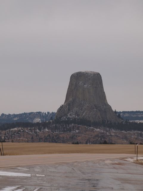 Devils Tower, a volcanic formation in Wyoming, as seen from a distance across the valley. [Credit: moi]