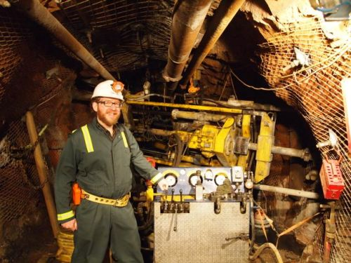 Portrait of the writer with a very big drill. This was taken in the former Homestake gold mine, which now houses the Sanford Underground Research Facility, including the LUX dark matter detector. [Credit: moi]
