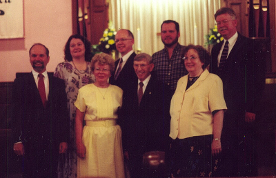 My maternal grandparents (center) at their 50th wedding anniversary, surrounded by their children, with their spouses.