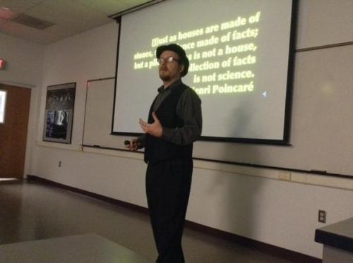 The problem with claiming to know something is that people take you seriously sometimes. Here I am speaking at the astronomy department at New Mexico State University about science communication. [Credit: Meredith Rawls]